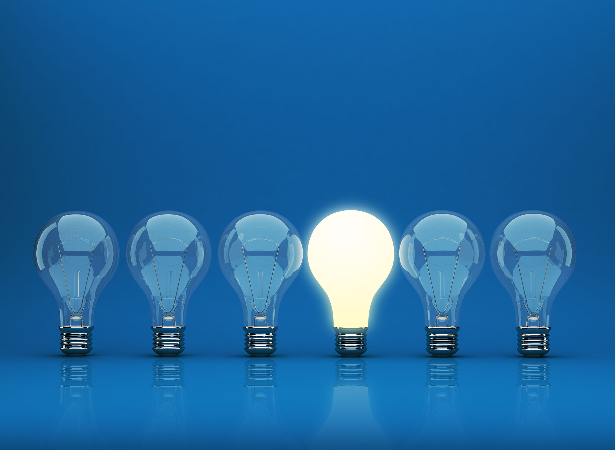 3D image of row of light bulbs on blue background. Incisive thinking & impartial advice.